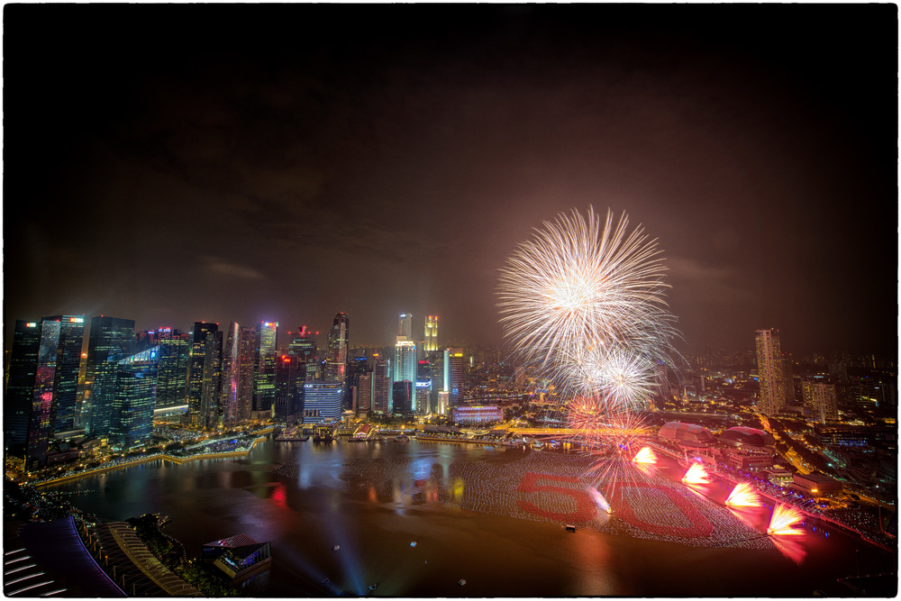 Fireworks over Marina Bay usher in 2015, also the 50th year of Singapore's independence.