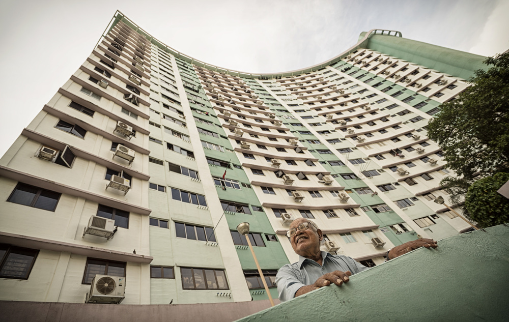 Unlike some, retired teacher Paul Fernandez was eager to live in an apartment. He paid $12,500 for a flat in Queenstown, Singapore's first public housing estate, in 1973 - and has lived there since.