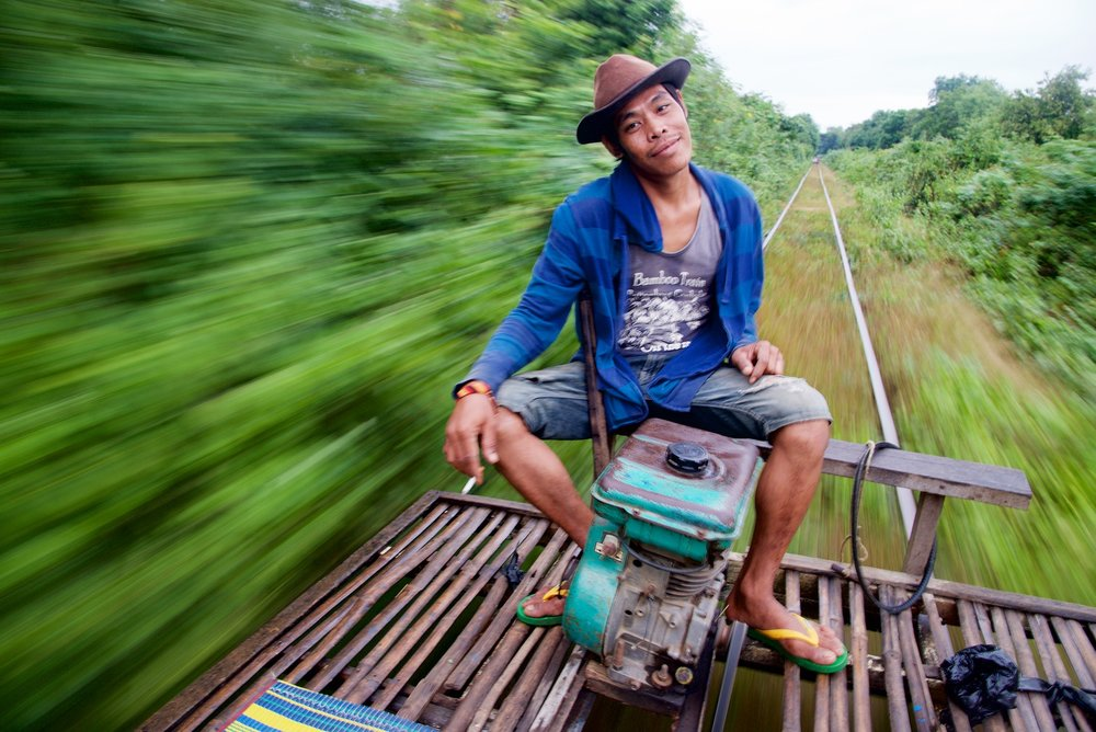 Bamboo Train Pilot in Motion - Battambang, Cambodia - Copyright 2014 Ralph Velasco.jpg