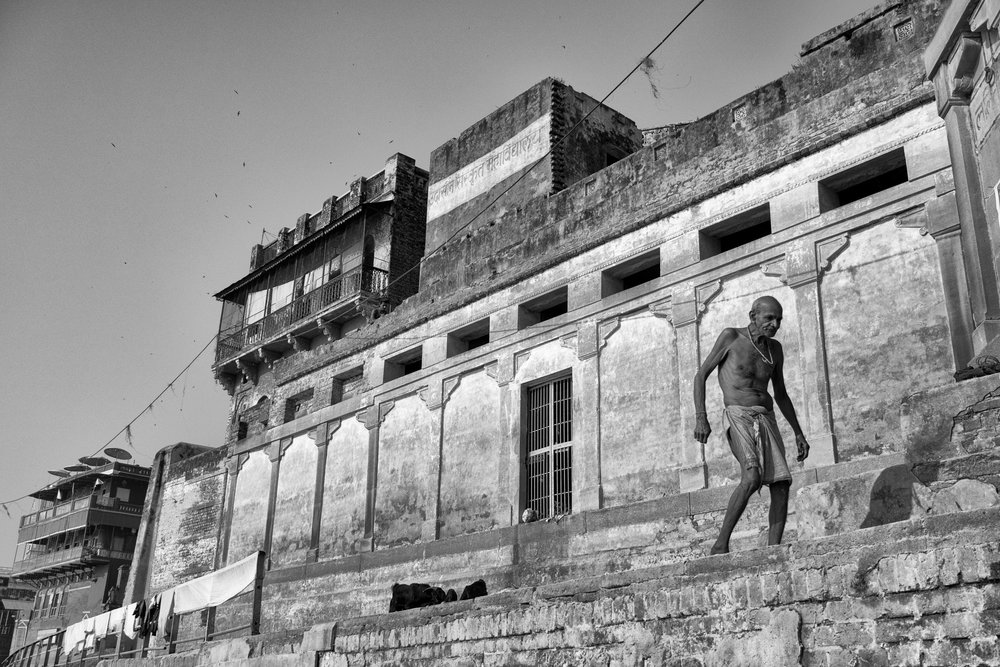 Man Walking Along Ghat Framed Against Wall in Black and White - Varanasi, India - Copyright 2016 Ralph Velasco.jpg