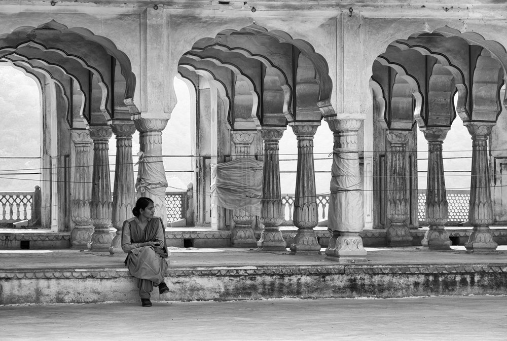 Woman Sitting by Scalloped Arches at Amber Fort - Jaipur, India - Copyright 2016 Ralph Velasco.jpg