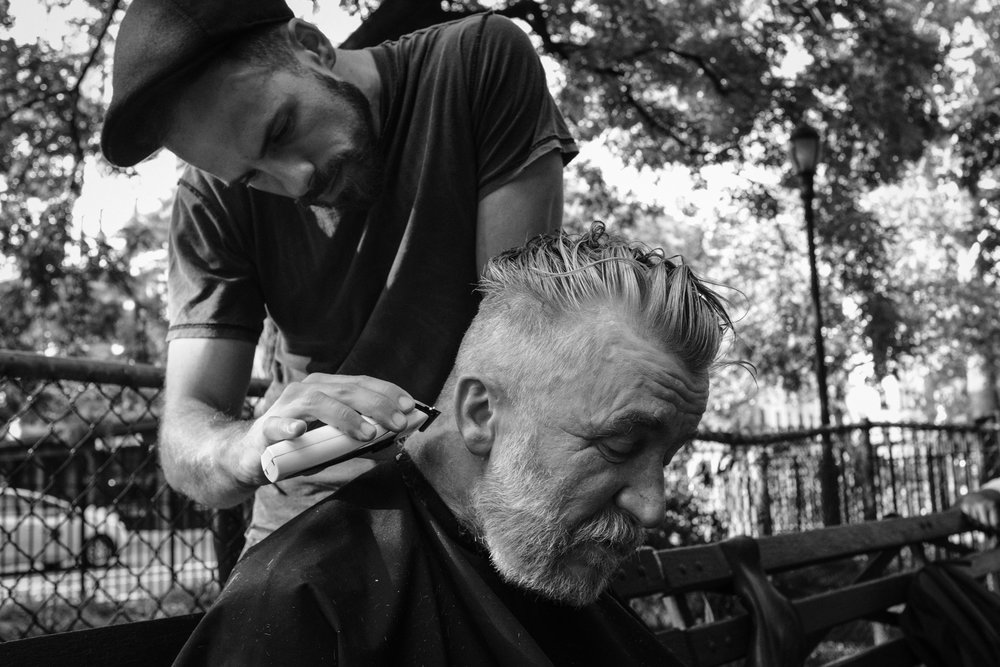 NYC: Janusz is telling his story while Josh is listening and giving him a new look. Janusz left the park with a new spark in his eyes and a spring in his step! See all the NYC photographs in  this gallery .