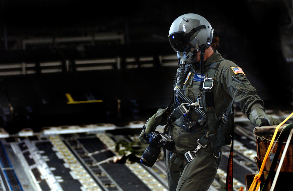 Stacy Pearsall Staff Sgt. Stacy Pearsall prepares to document an aerial formation from the ramp of a C-17 Globemaster aircraft during a high altitude, low oxygen flight, Charleston Air Force Base, SC. U.S. Air Force photo