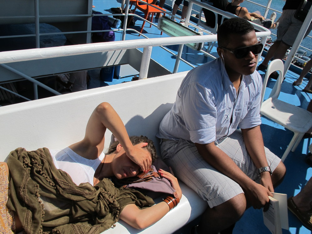 Danai and Andrew looking restless after a few hours on the boat. Check out their frowns LOL.