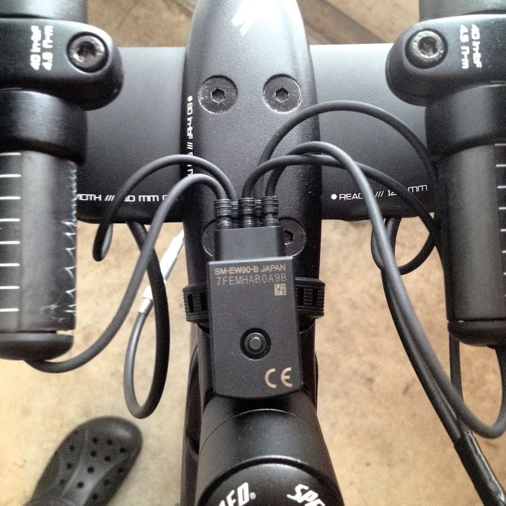 Detail of the electronic hub. This takes signals from the four shifters and then routes them to the derailleurs. To charge the system, you can simply plug in to this. Although the system does have a removable battery, on this bike it's actually hidden in the seat post instead of under the left chain stay, where many people put it.
