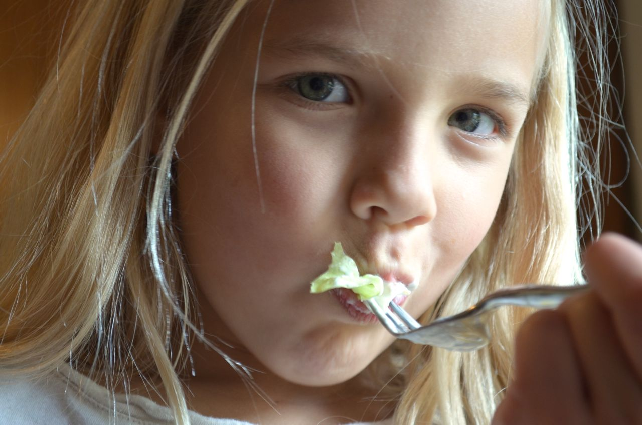 Kids eat salad