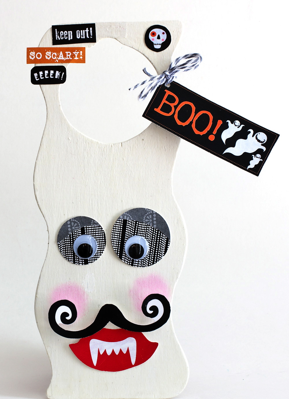 mambi embellishments to make a cute ghost/halloween door hanger.