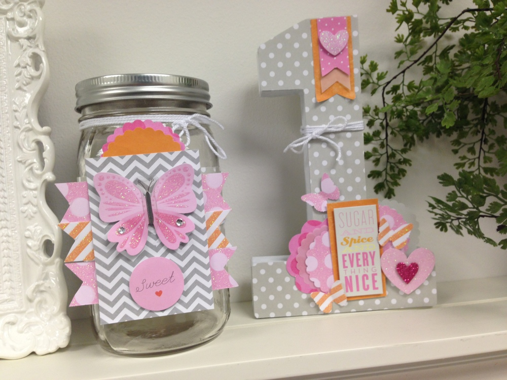 me & my BIG ideas scrapbook goodies to decorate a little girl's room.  Jar decorated and #1.