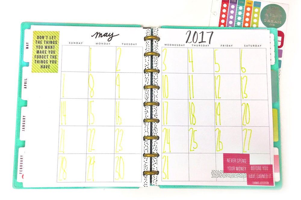 using the monthly pages of the happy planner budget extension pack