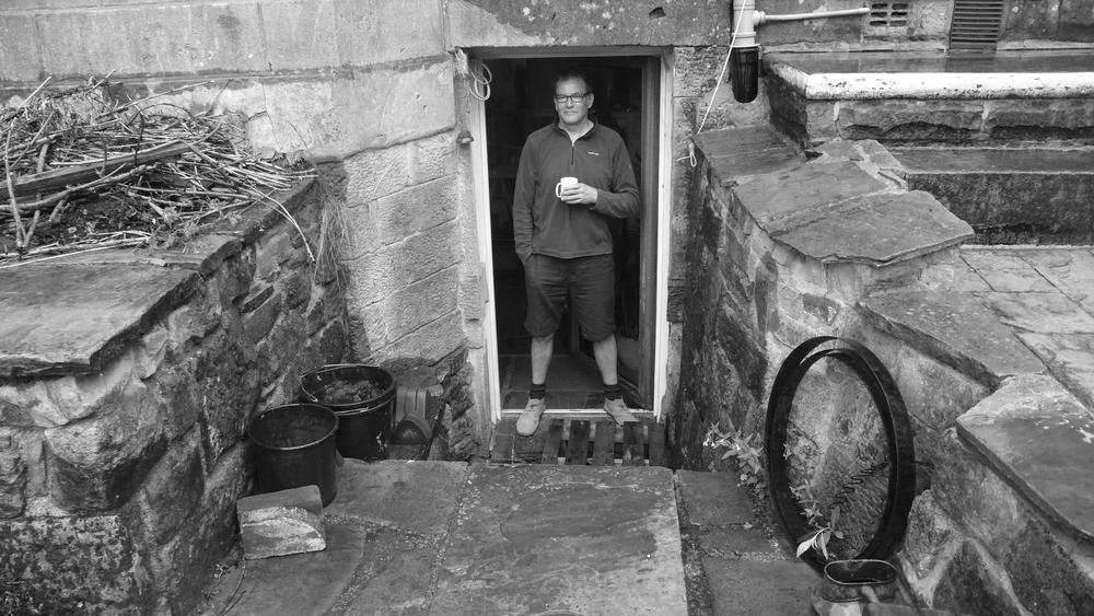 Dan having a brew at the BLOTT WORKS workshop door.