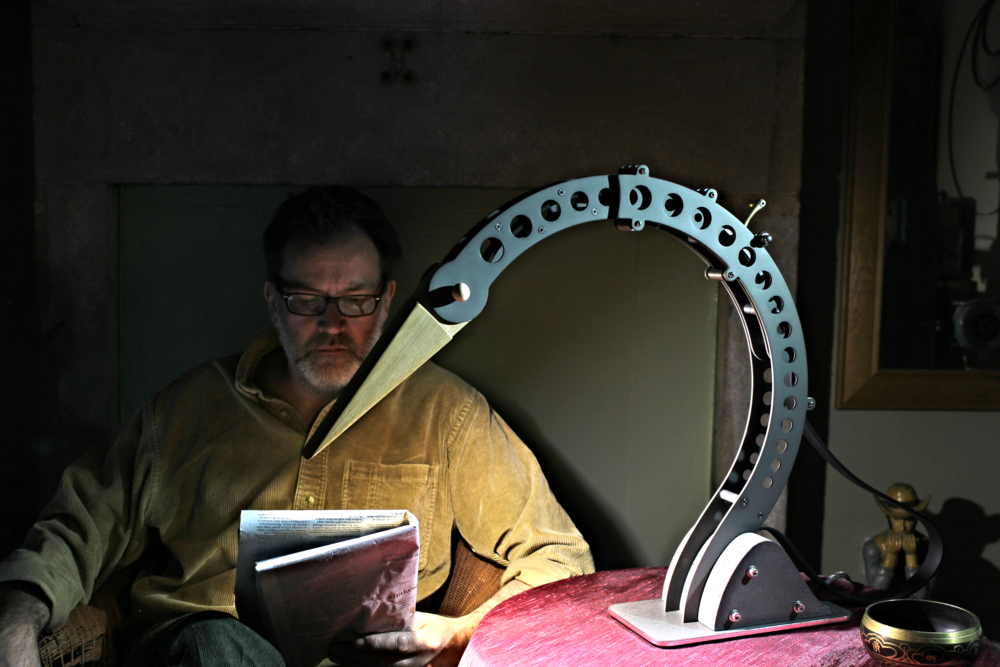 Founder Dan Morrison taking it easy with his Crane desk lamp and a newspaper