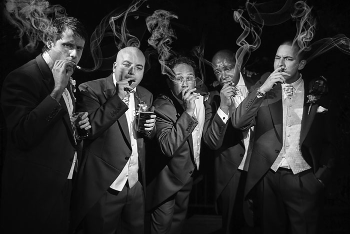 London wedding photographer, Film Noir, Male Groups at weddings, Black and White, cigars, lighting.jpg