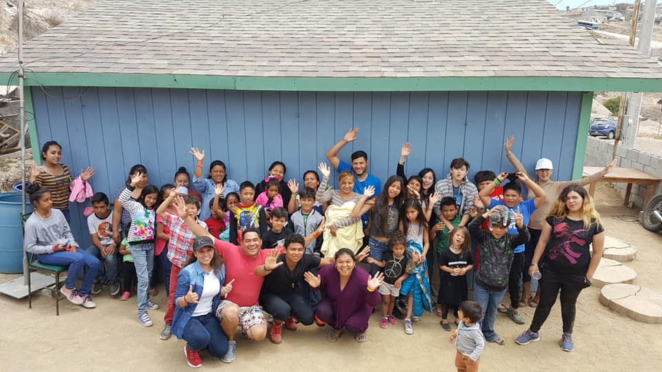 David and Daisy (front and center) celebrating with the children and families that take part in their feeding center.
