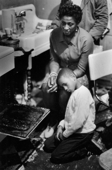 Family Crowds Around Open Oven for Warmth, Harlem, New York, 1967
