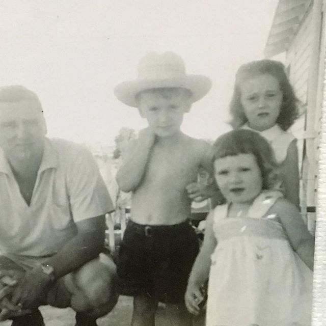 "Happy Father's Day! Today, we feature a friend of Storyhouse and one of our favorite dads (center): ""This was likely at our home in De Leon, Tx and I would place the year as 1956 (summer). That's my dad J. D. Roch and my two sisters Katy (she would be 5) and Nancy (1 1/2). I am 4 years old. Brother Mark had not joined us yet. He came in 1958.  I have always considered this to be my first hat."" We ❤️ you, Paul Roch! Happy Father's Day!"