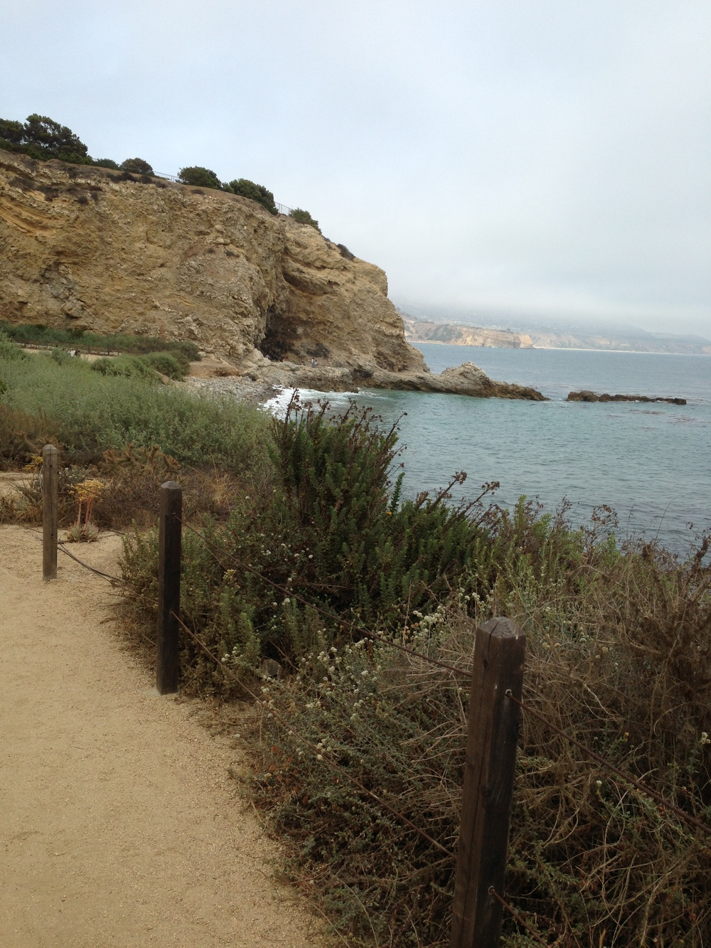 Ocean, rocky cliff, pebbled walk way ---- Loving SOCAL!