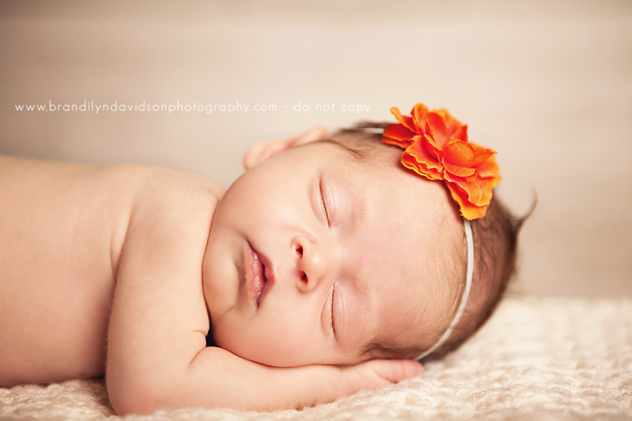 newborn-baby-girl-in-orange-headband-by-tri-cities-newborn-photographer-brandilyn-davidson-photography.jpg