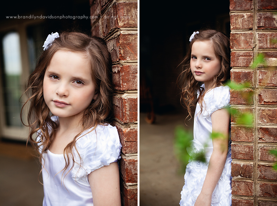 allie-in-white-baptism-dress-by-brick-wall-in-johnson-city-tn-by-brandilyn-davidson-photography.jpg