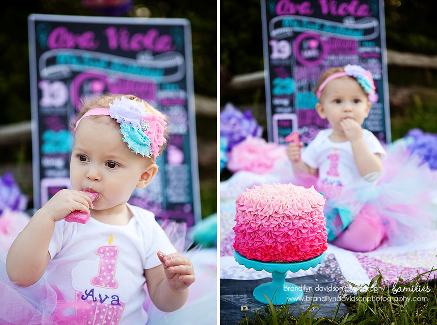 ava-eating-candle-on-5.20.14-by-smash-the-cake-photographer-brandilyn-davidson-photography.jpg
