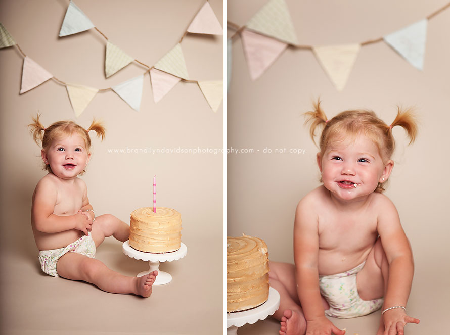 ari-smiling-with-cake-smash-on-10.28.14-by-grass-valley-ca-photographer-brandilyn-davidson-photography.jpg
