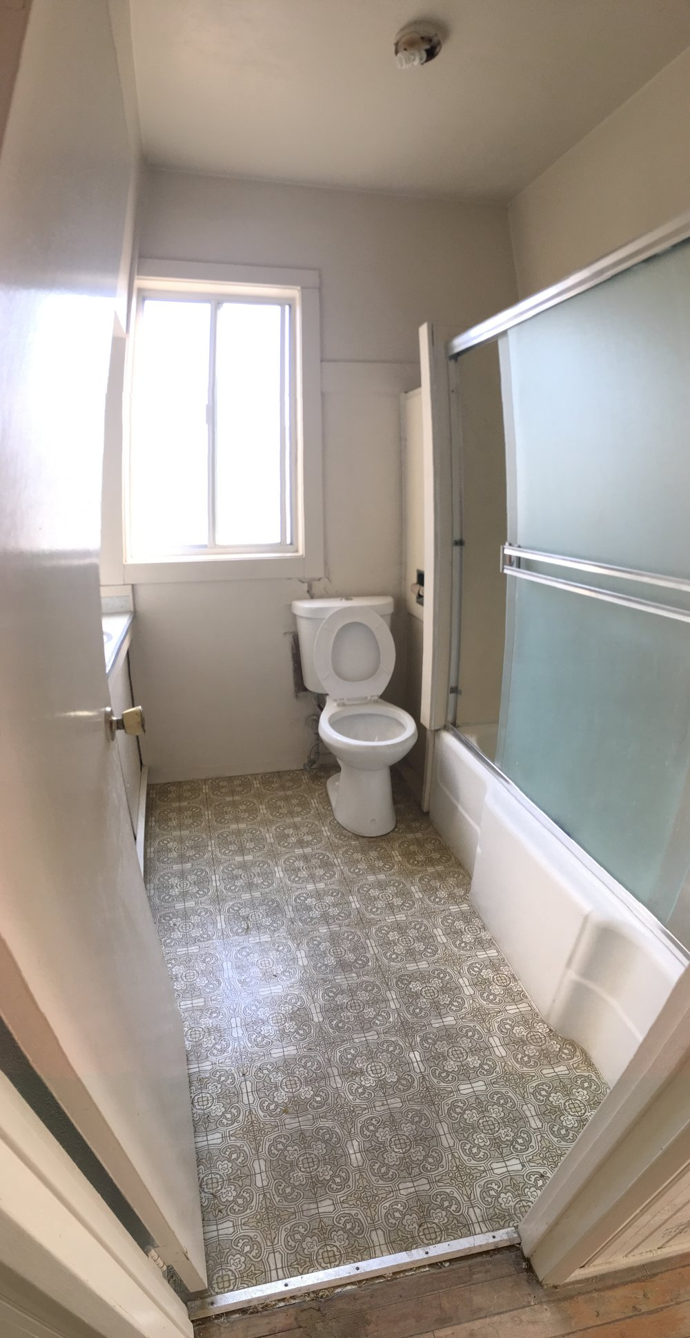 Main bathroom with poorly placed toilet