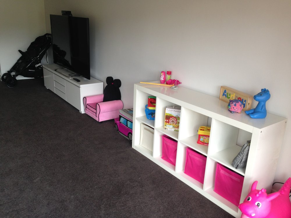 A dedicated storage space for toys that were often used in the space.