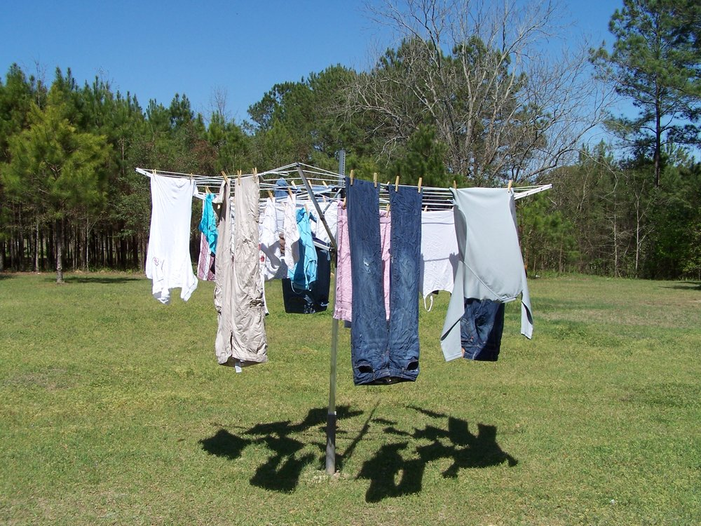 Outdoor Line  - Drying clothes in the sun gives them a fresh smell and is usually quick- You must use pegs to ensure items do not fall off- Do not overlap items - Pin at the edge of clothes, not in the middle
