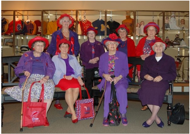 A group of Red Hatters pause during their tour of the museum's gallery.