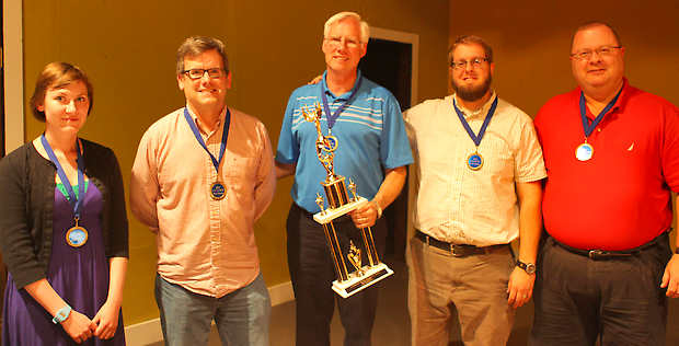 "Bedford Laser Wash members, from left, Chelsea Jensen, Joe Voris, Dennis Whitaker, Terry Tlustek and Dennis Martin pose with the Brain Games XII trophy after winning the championship on Thursday, May 23. Photo by Marcey Burton, ""Times Mail"""