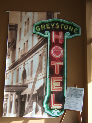 The large photo of the building and almost lifesize reproduction of the hotel sign was created and donated by Johnny's signs.