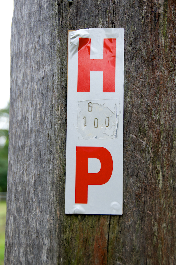 Sign on telegraph pole