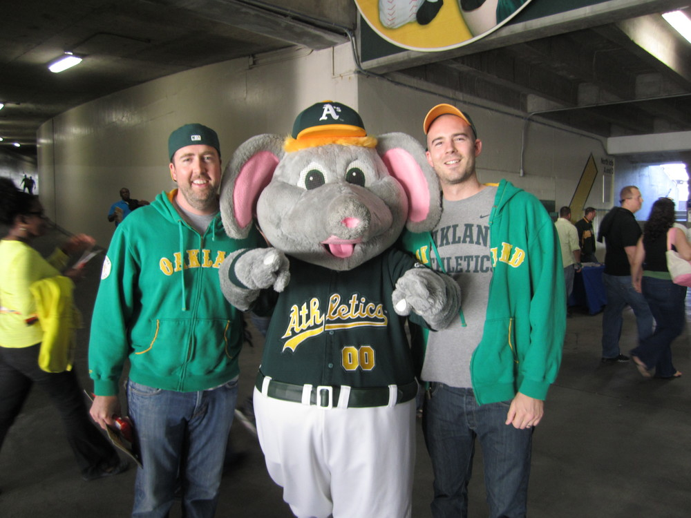 John Hansen (left) and John Jackson (right) wearing matching sweatshirts and hanging with Stomper.