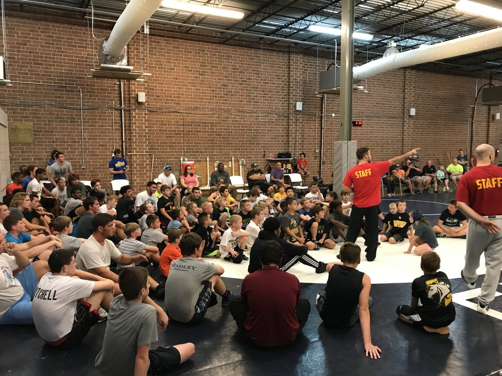 Coach Casey briefing wrestlers at Weekend Wars
