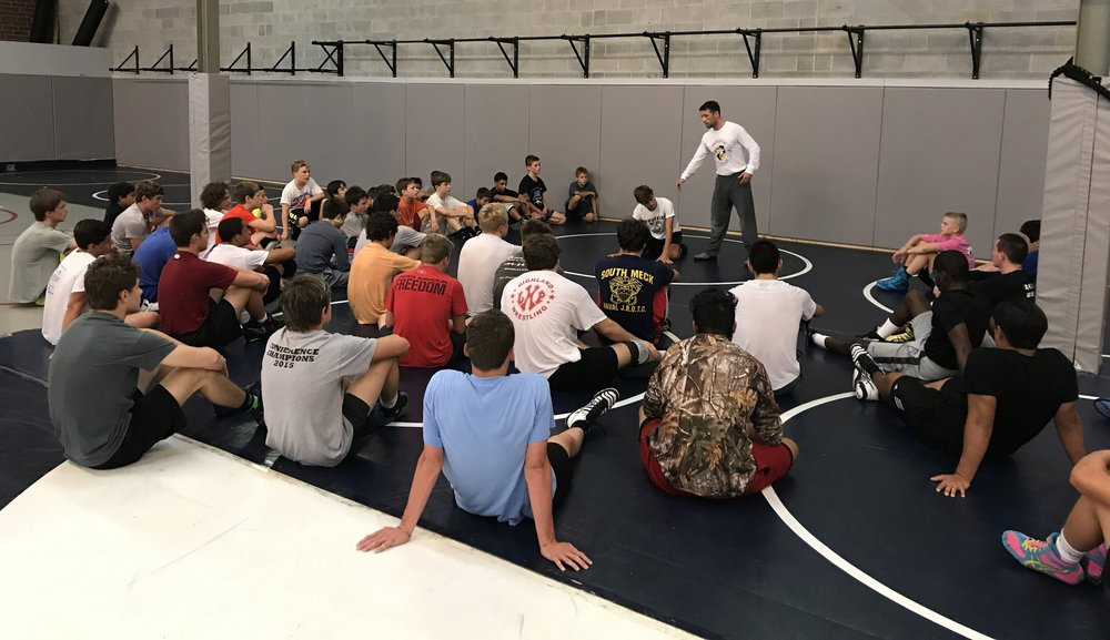 Darkhorse Wrestling's Coach Casey teaching wrestling at the August Summer Camp.