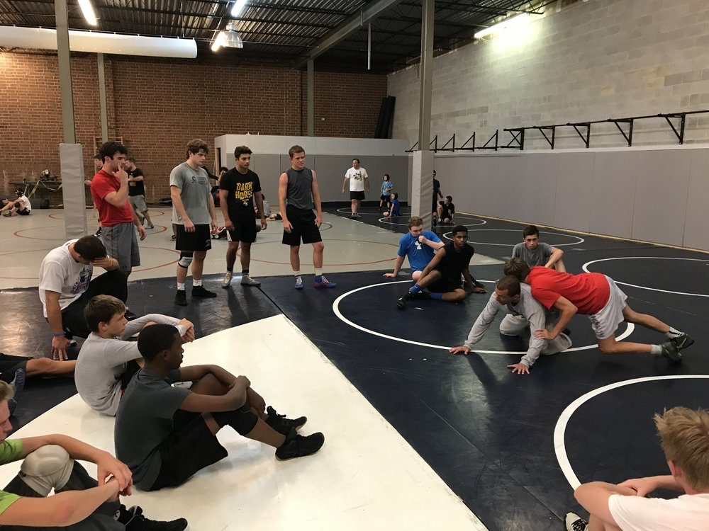Darkhorse Wrestling's Coach Ian Assael during a camp breakout session.