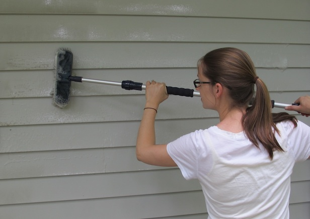 BUDGET ALTERNATIVE: WASH EXISTING SIDING  Cleaning vinyl siding costs next to nothing, so homeowners who can't stomach spending thousands on stone may want to invest some elbow grease instead. The Vinyl Siding Institute  recommends  using a soft-bristled brush, mild soap, and water to clean siding. Its website also features a list of recommended cleaners for grimier jobs and specific stains such as rust or grease. Power washers are fair game as long as the siding manufacturer allows them, but be sure to follow all directions. For instance, aiming a power washer higher than eye level can drive water behind the siding, experts warn.