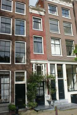 SINGEL 166 IN AMSTERDAM, HOLLAND  This unassuming building is the narrowest house in Amsterdam at just under six feet wide. Like many narrow homes, however, the house gets more spacious as it extends back from the street.