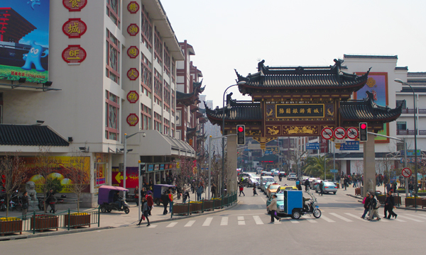 A traditional styled Chinese gate in the street.