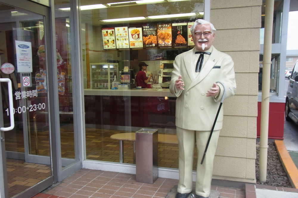 A Colonel Sanders statue outside of a KFC in Japan.