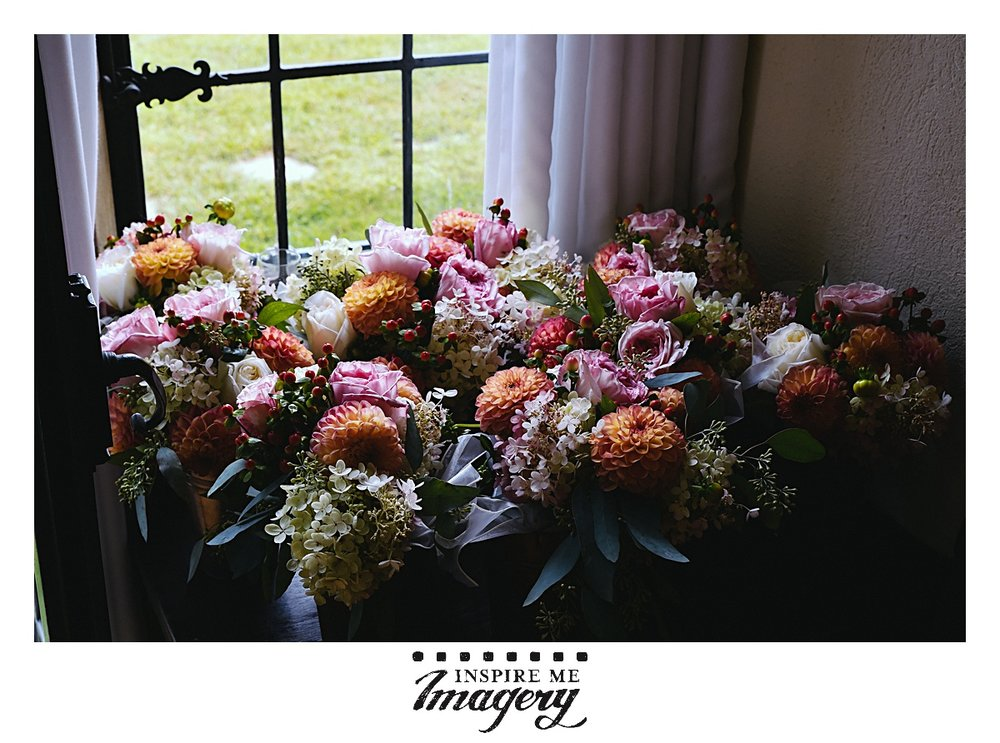 This was a September wedding, and the colors for the flowers were just stunning with the oranges, pinks, and purples.