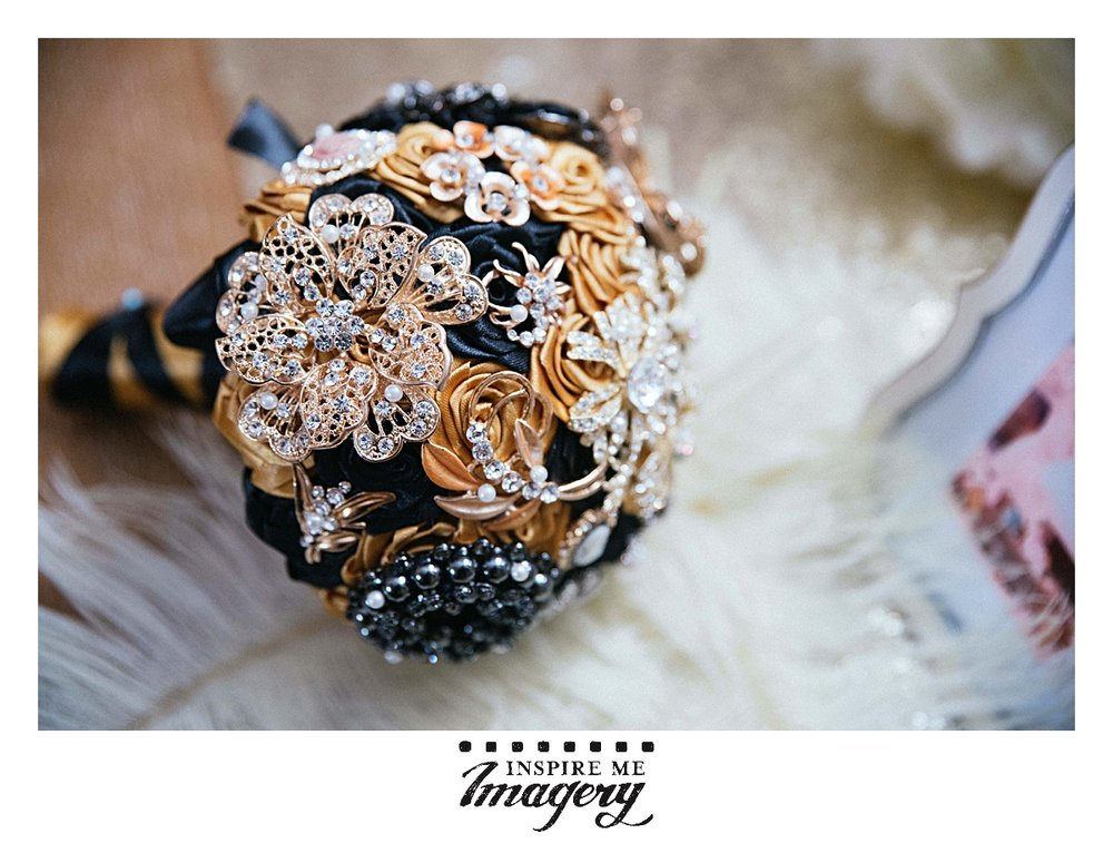 This brooch bouquet was stunning. The gold and blue in the pins came together so well.