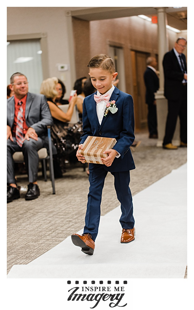 The little man did the job well! Bring a ring bearer is serious business.