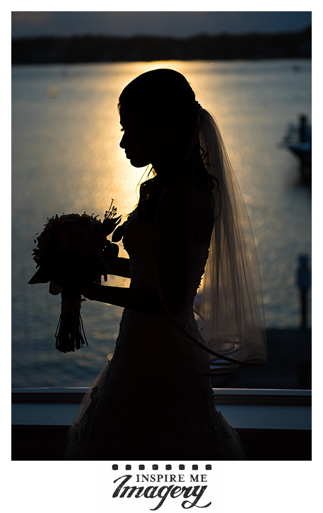 We took this portrait super quickly, right after the first dances ended. The bride stood next to the sweetheart table, followed our quick posing directions, and then was able to continue enjoying the evening. Like we said, the view from the reception room at Clarks Landing Yacht Club is killer.