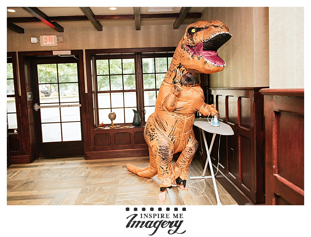The bride gave her groom this amazing T-Rex costume as his wedding day gift. A lot of fun was had.