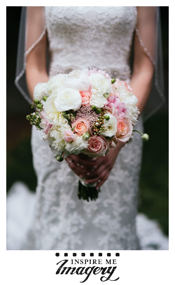 The bride's bouquet was a beautiful combination of soft pinks, creams, and peach.