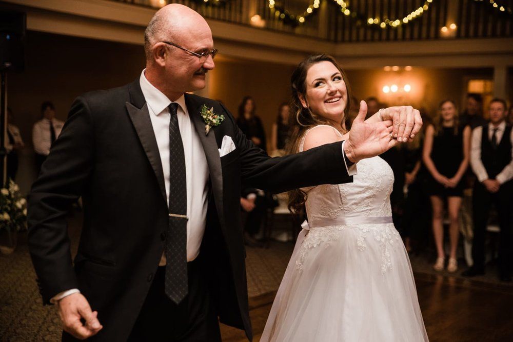 """Nicole Ericson - We took dance lessons, which admittedly weren't sure we'd get through after the first one. He said I was being bossy or something... But I can't imagine where I might have gotten that 🤔. We made it through and enjoyed it, but during the dance I winced and said, """"I'm stepping on my dress... that's all that's under my feet."""" He took it from there and we winged the rest and no one was the wiser. We danced to Sugar Ray """"Someday."""" I told him at 12 on the way to a softball tournament that was the song we'd dance to at our wedding. Thanks for capturing these moments!!!!"""