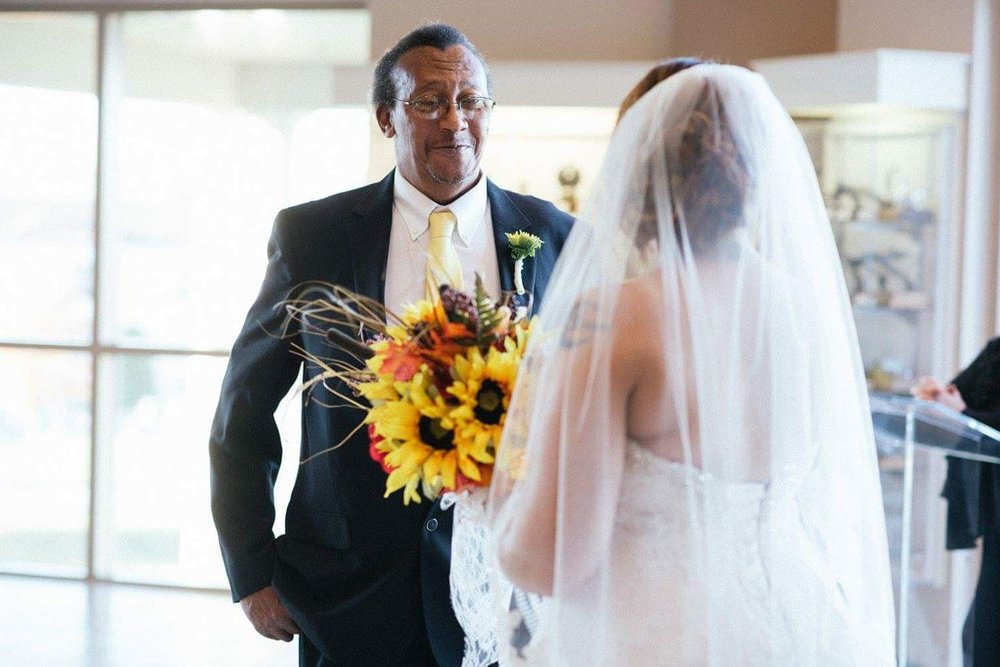 Holly Patterson -My dad seeing me in my dress for the first time before walking me down the isle with my mother