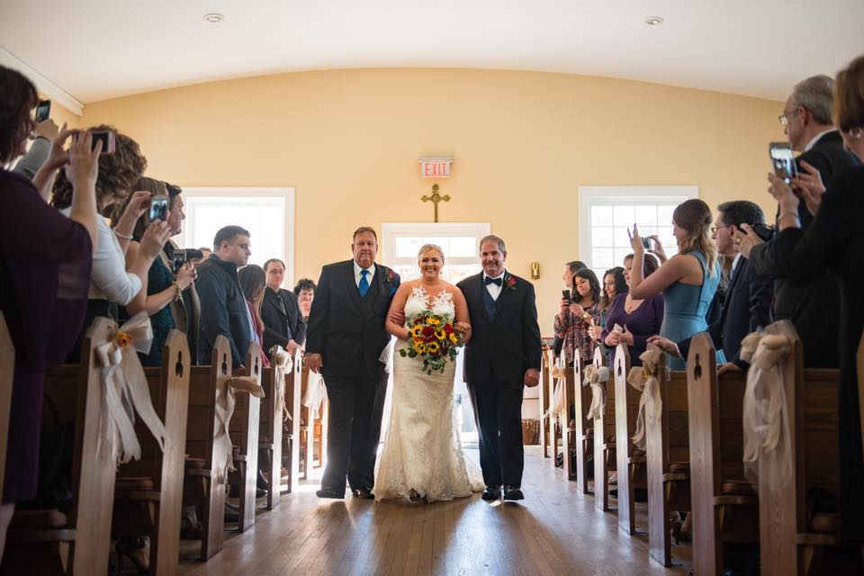 Kim Acerra - Couldn't choose just one! Loved having both my father and step-father walk me down the aisle. And capture my hubby's reaction to seeing me for the first time 💕