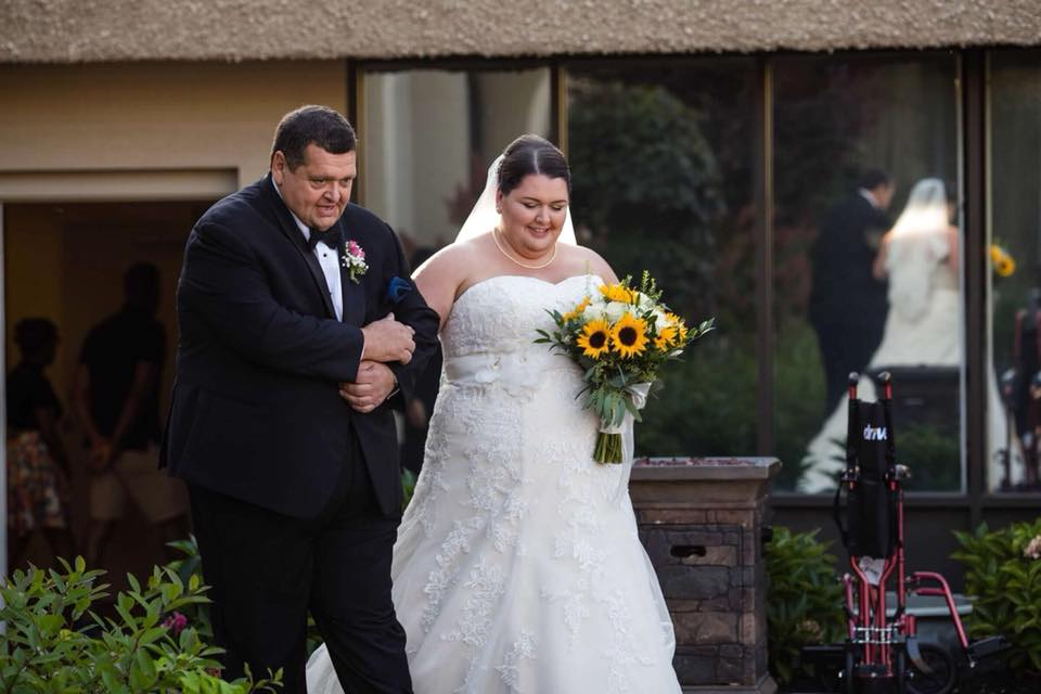 Jen Povio - My dad , lovingly known as Pops (by my brothers and me) or Papa Bear (by my daughters), walking me down the aisle. We only got a few minutes together during the wedding just he and I, and the look on his face says it all. What a great day and great guy.