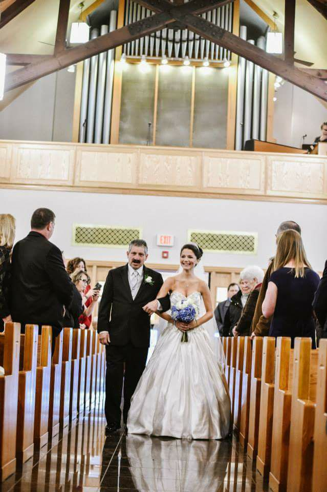 Maggie Cooney - The pictures are special to me because I remember walking down the aisle and whispering to my dad not to cry. I love the second photo of the reflection